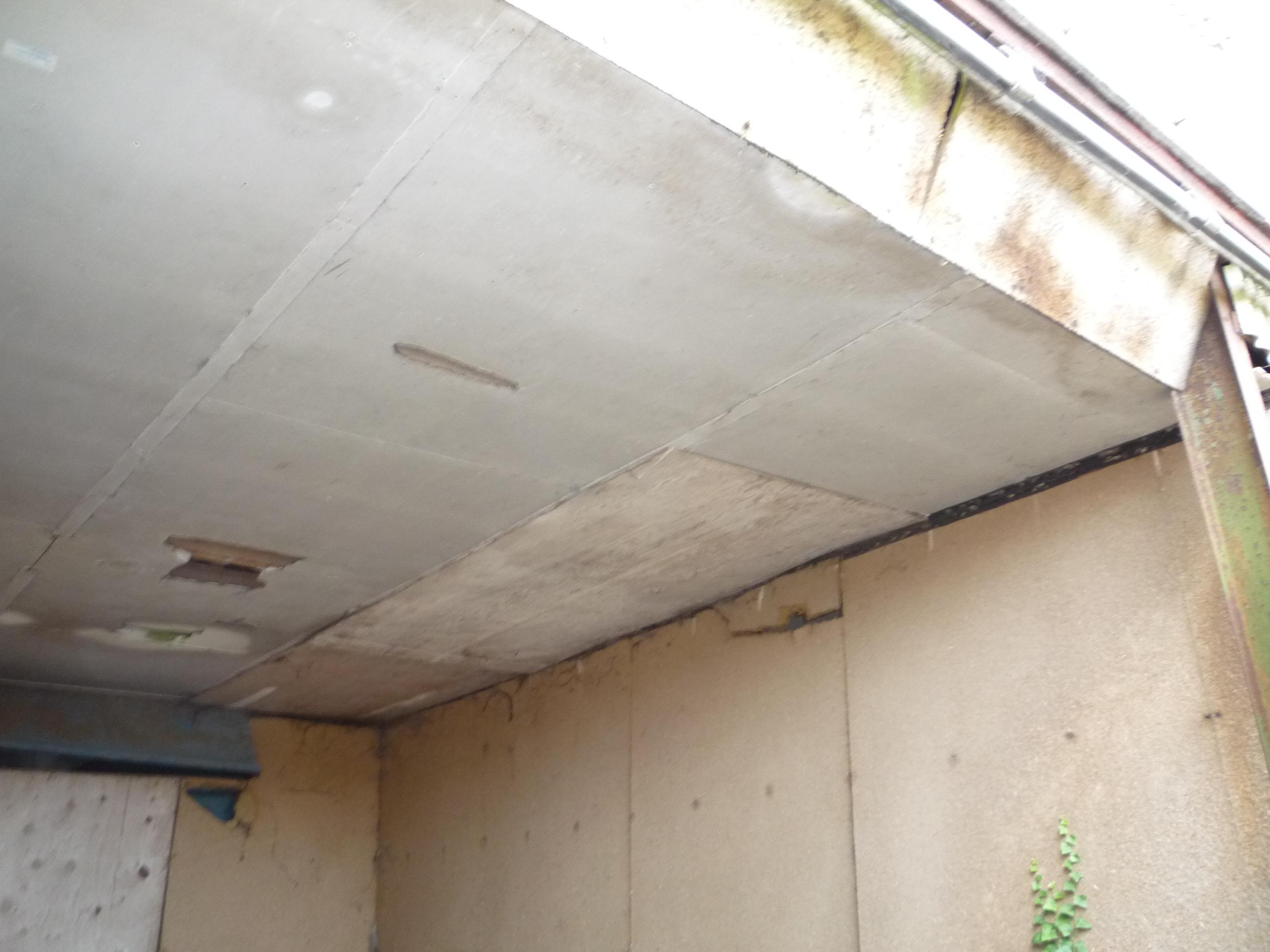 Asbestos insulating board ceiling